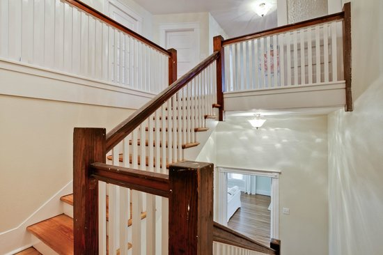 Craftaway Studios: A wide staircase leads to the sleeping rooms upstairs.