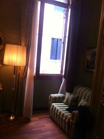 Hotel Al Ponte Mocenigo:                                     Two big windows overlooking canal like this one