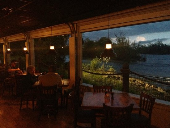 Riverfront Seafood Company: The view of the river with doors up at sunset