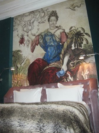 Hotel du Petit Moulin :                   Mural above our bed.