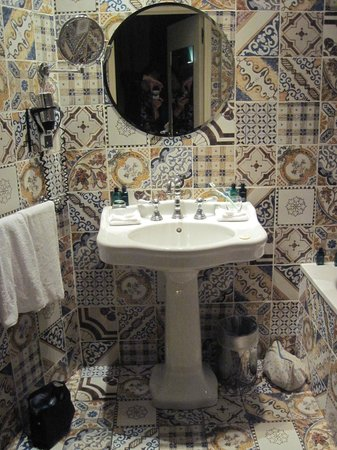 Hotel du Petit Moulin :                   Sink in bathroom.