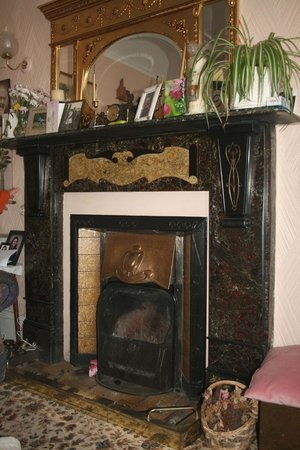 Whitehead Conservation Area: Original slate and copper fireplace, no. 13 Kings Road.