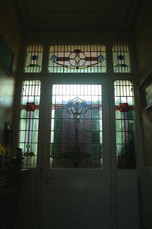 Whitehead Conservation Area: Art Nouveau symmetrical floral doorway glass, no. 13.