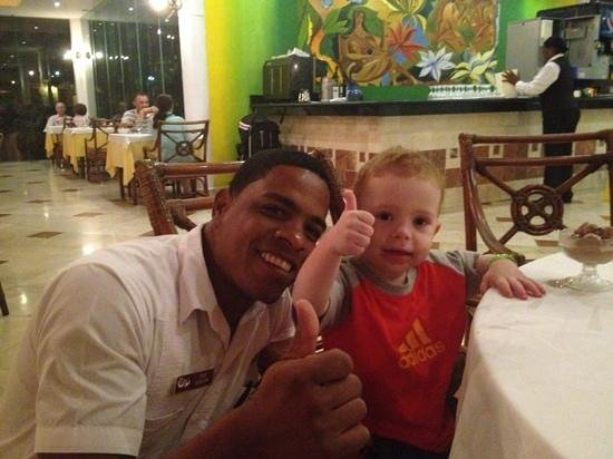 Grand Palladium Punta Cana Resort & Spa:                   this is my son with one of the waiters in the buffet, his name is Feliz, and h