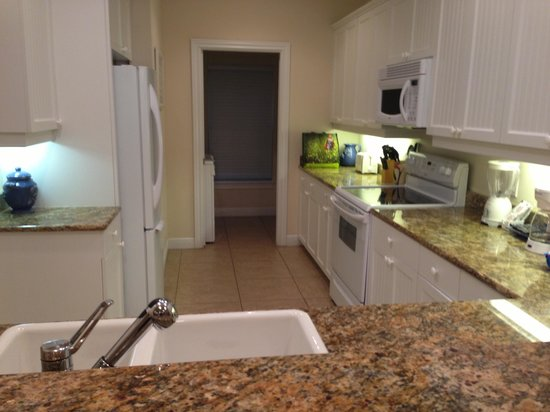 Tortuga Beach Resort:                                     View of kitchen area rm 260 - w&d thru door
