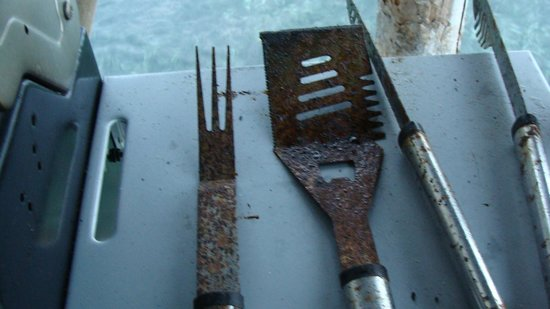 Bocas Villas:                   Common area RUSTED bbq tools