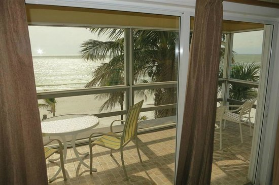 Tiki on the Beach:                   screened porch on second floor apartment