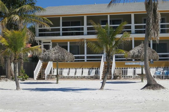 Tiki On The Beach:                   back of hotel with six units, three on top with screened porch & three on lowe