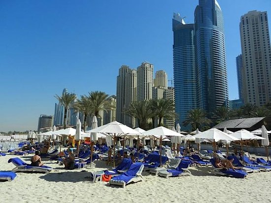 Hilton Dubai Jumeirah: View of beach area looking back towards marina