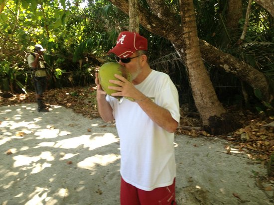 Ylang Ylang Beach Resort :                   Drinking from Coconut on the Beach. Just don't get no better than that !!