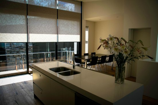 Lakeshore Springs:                                     Sunlit Kitchen and Dining area, off Rear Balcony. Elevator a