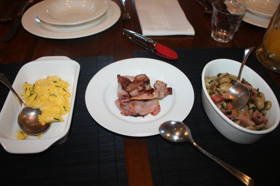 TARA Guest House:                   Creamy scrambled eggs, grilled bacon, sauteed mushrooms