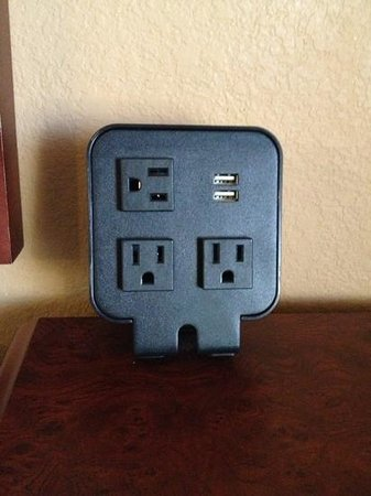 Hampton Inn and Suites Lake City:                   plugin device next to bed