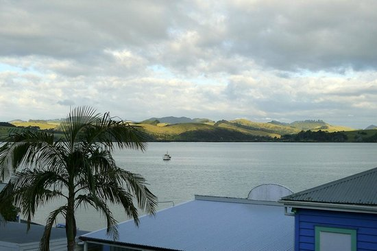 Mangonui Waterfront Apartments:                   The view from Whitu, behind and above the main (blue) building.