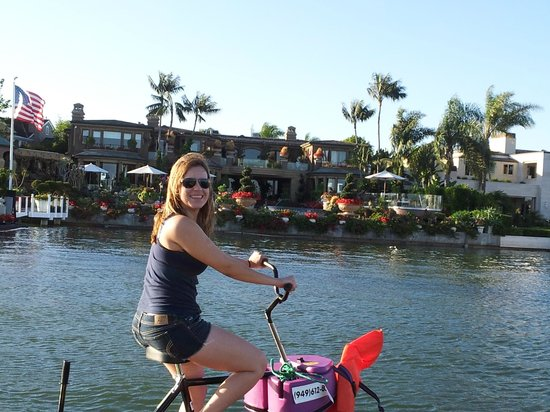 Pacific Coast Hydrobikes Enjoying The Up Close View Of Beautiful Houses
