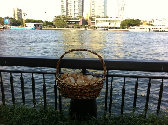Shangri-La Hotel,Bangkok: Baskets of bread to feed the fish in the river