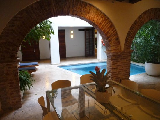 Casa Claver Loft Boutique Hotel :                                     View of ground floor pool from our private breakfast area