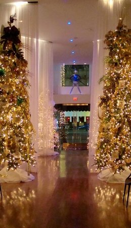 The Saint Hotel, Autograph Collection: Lobby at Christmas looking towards Canal St.
