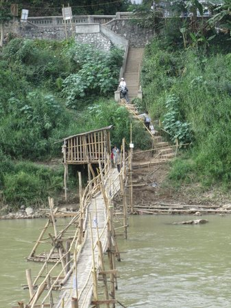 Phone Praseuth Guesthouse:                   bamboo bridge leading to town