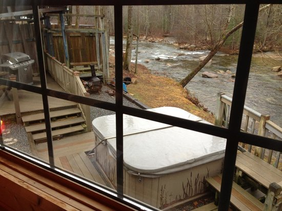 Brown Mountain Beach Resort:                   View of outside deck area with Hot tub and Chiminea behind the Firefly Cabin