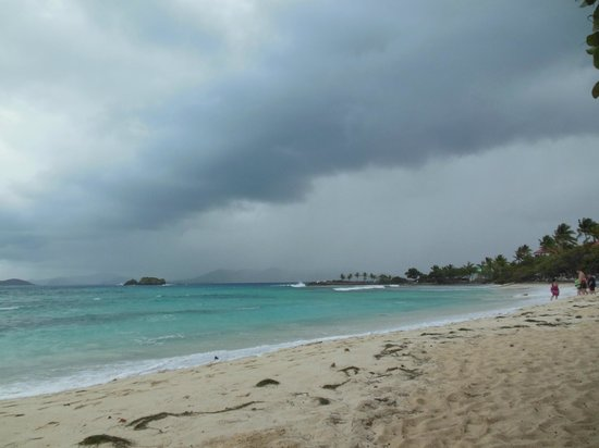 A short rain storm rolls in over Sapphire Beach