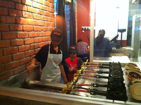 Portuguezze Kitchen :                   Chef Sheena on grill's