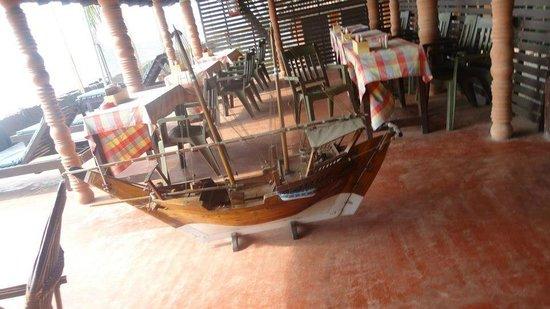 Brighton Beach House:                   Restaurant area with a replica of a ship