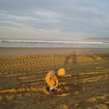 Oxford Suites Pismo Beach:                   Sunrise Service at the Beach. He is building a Castle.
