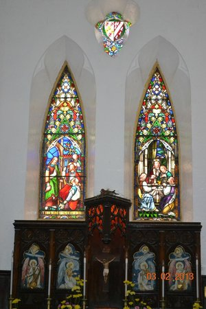 St. John's Church:                   stained glass, note the dove nesting above crucifix