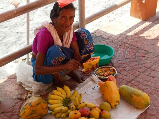 Lighthouse Beach :                                     our friend fruit seller lady cutting fruits for us