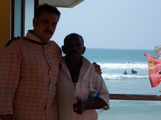 Lighthouse Beach :                                     My 5 years friend at kovalam beach Suft pad seller