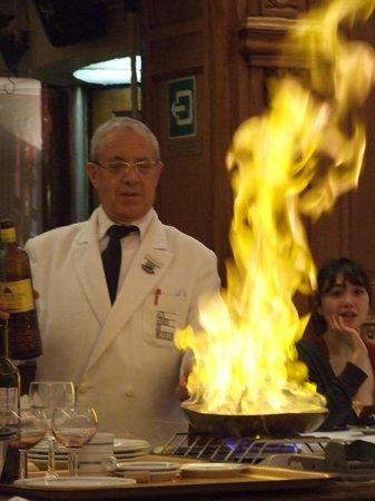 Aux Armes de Bruxelles:                   They flambé pancakes in the middle of the restaurant!