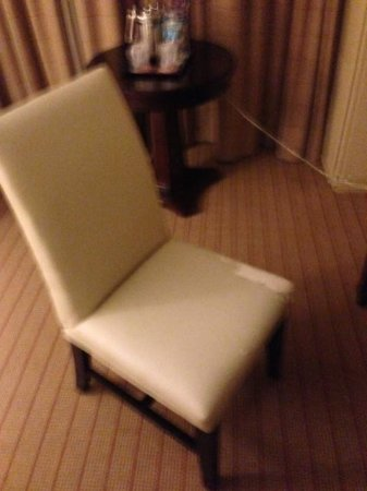 Sheraton Austin at the Capitol:                                     Put a towel down before you sit in this gross chair