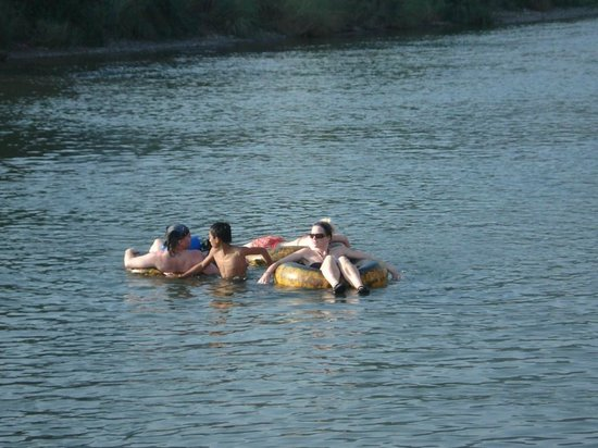River Tubing:                   People getting to the end point of the tubing.