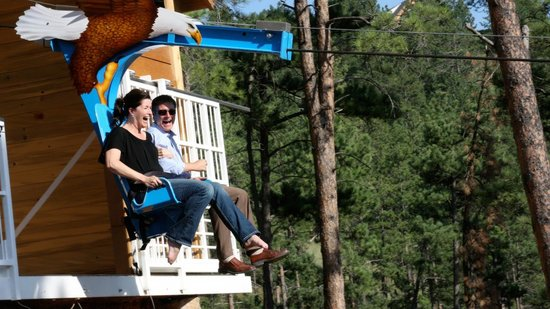 Rush Mountain Adventure Park : Couple having a great time on the Soaring Eagle Zipline at Rushmore Cave