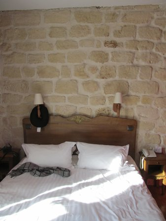 Hotel Europe Saint Severin:                   view of the bed - loved the exposed brick