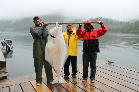 Baranof Wilderness Lodge:                   New friend Carol and her catch of the day with Captain Dave and dock hand Matt