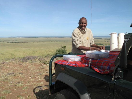 Mara Explorer Camp :                   Vincent, our guide, serving breakfast