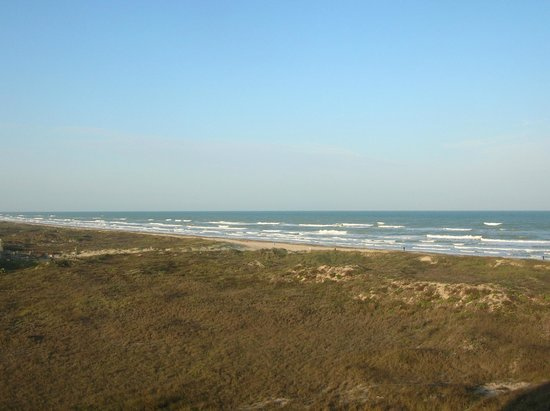 Hilton Garden Inn South Padre Island:                   A view of the beach from our room on the north side of the hotel.
