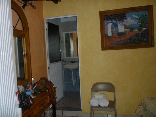 Carmelita's Hotel:                   looking into bathroom