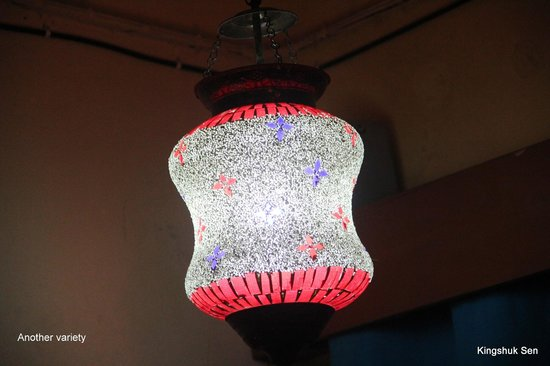 Decent Lites:                                     An Artiistically crafted glasswork (hanging lamp) typical Fi