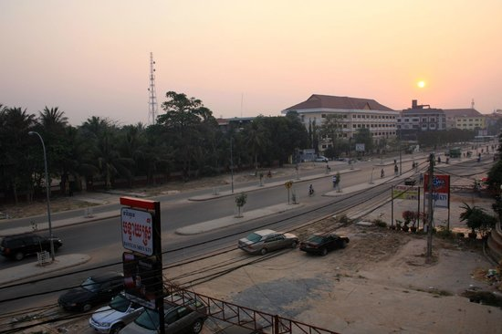 Rotha Guesthouse :                   Sunrise over Cambodia, view from corridor balcony