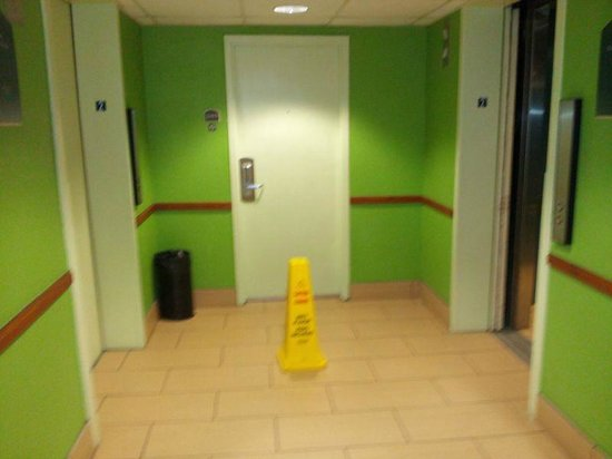 Emerald Beach Hotel:                   Hotel room door BETWEEN the elevators. Warning cone there during our entire st
