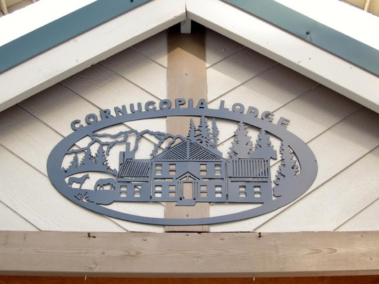 Cornucopia Lodge: Our beautiful sign on the front of the lodge
