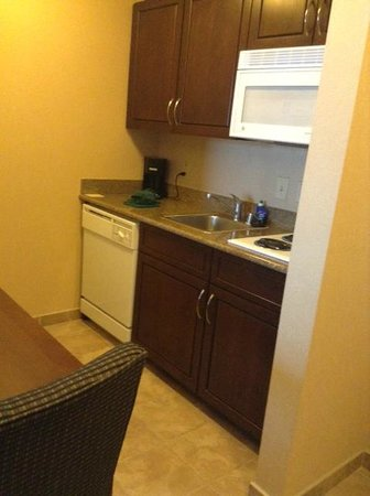 Homewood Suites by Hilton Henderson / South Las Vegas:                   Kitchen area with microvave, full fridge, and cook top.