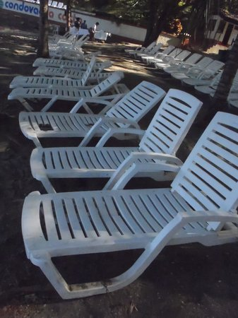 Villas Sol Hotel & Beach Resort:                   Chairs at the beach. All of them were broken.