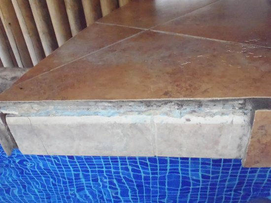Villas Sol Hotel & Beach Resort:                   The wet bar with missing tile.