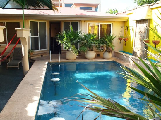 Cascadas de Merida :                   The pool area. The four rooms are on the four corners of this space.