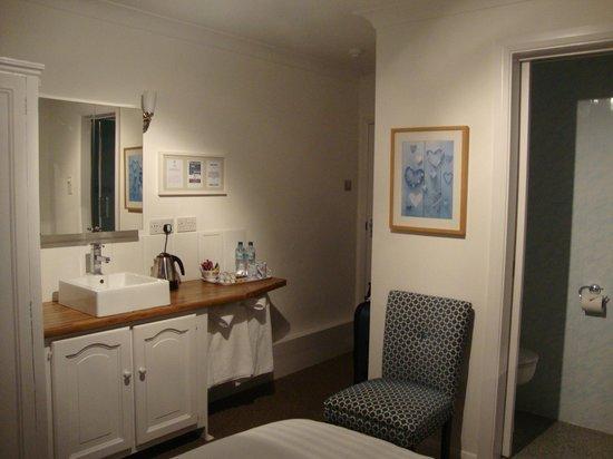 Fortitude Cottage: Vanity in the bedroom; glimpse of narrow en-suite