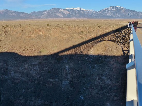 Rio Grande Gorge: Shadow of the center-span arch cast on the far side gorge. Bighorn sheep barely visible in the s